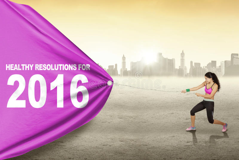 De mooie vrouw trekt tekst van gezonde resolutie voor 2016 vector illustratie