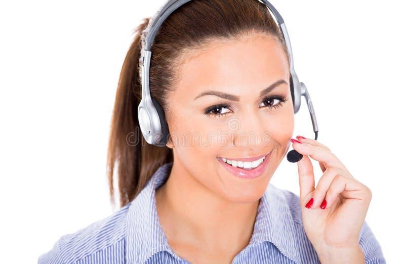 De mooie vrouwelijke vertegenwoordiger van de klantendienst of exploitant of helpdeskondersteunend personeel die een hoofdreeks dr royalty-vrije stock fotografie