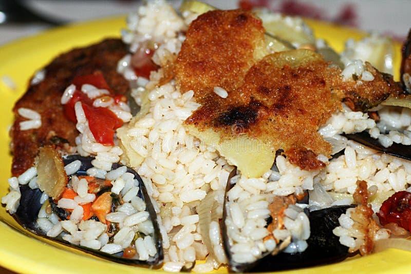 De mosselen van rijstpotatotos stock fotografie