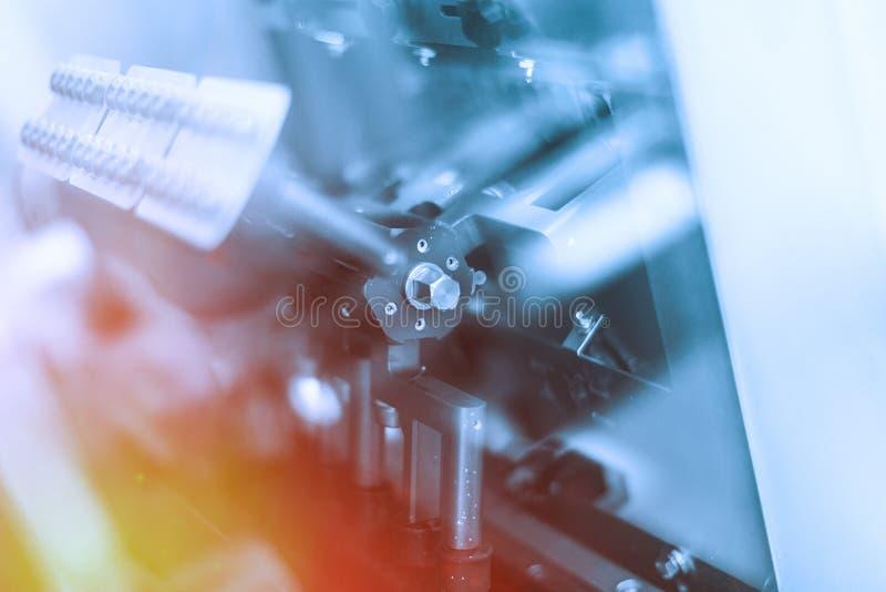 De motor van machine met bouten, centrifugeert Blauwe toon Blauwe tint stock fotografie