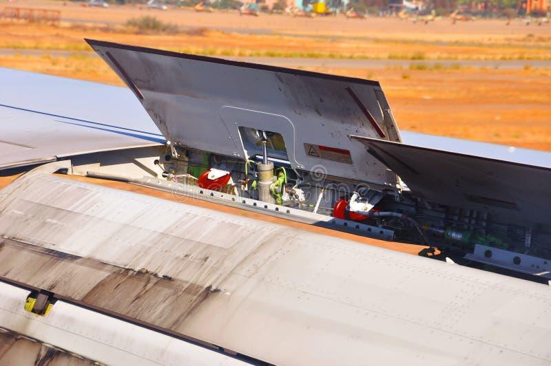 De motor van vliegtuigen van vleugel stock afbeeldingen
