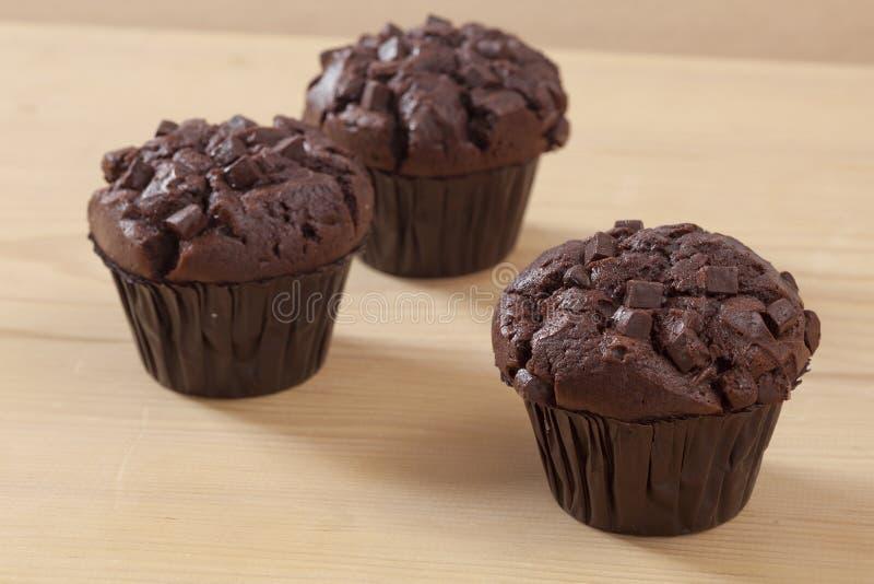 De muffin van het drie chocoladestuk royalty-vrije stock afbeeldingen