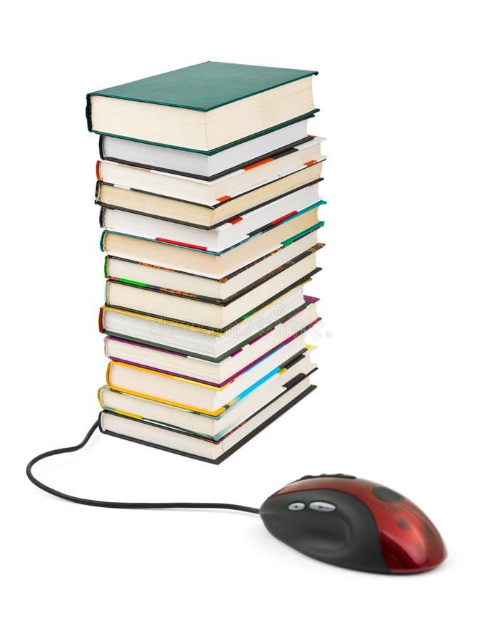 De muis en de boeken van de computer royalty-vrije stock fotografie