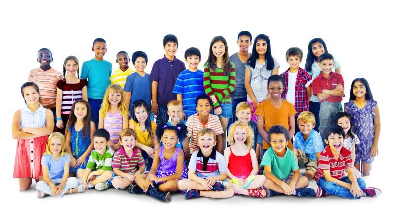 De Multi-etnische Groep van Happines van kinderenjonge geitjes Vrolijk Concept stock afbeelding