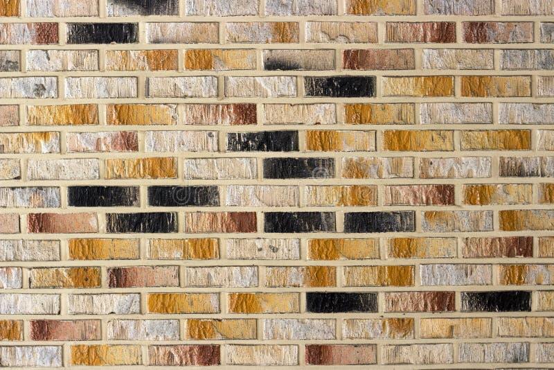 De Multi Gekleurde bakstenen muur dicht omhoog, textuur en achtergrond stock afbeeldingen