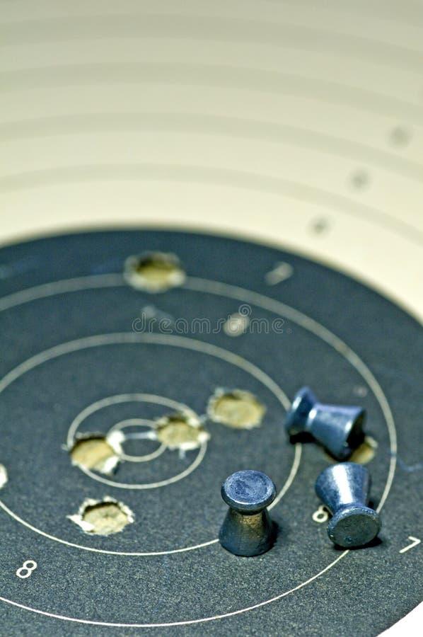 De munitie van Airgun met doeldocument royalty-vrije stock foto