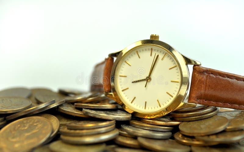 De muntstukken van het tijdgeld stock foto's