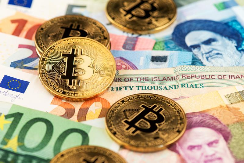 De muntstukken virtueel geld van Cryptocurrencybitcoin met Euro en Iraans Rial geld stock afbeeldingen