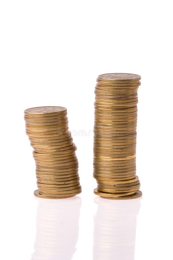 De muntstukkenkolom van het geld stock foto's