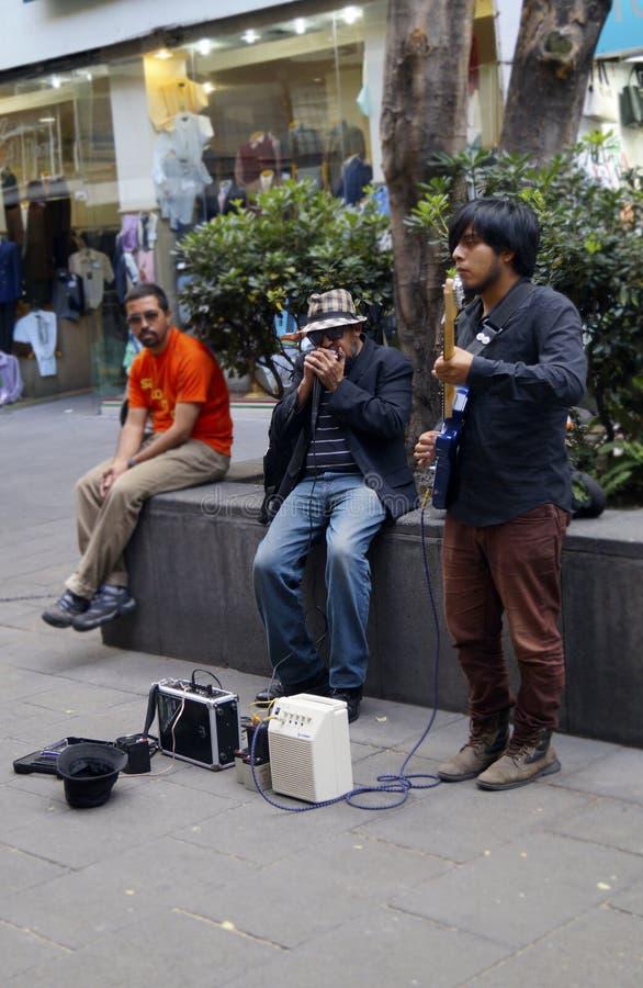 De musici van straatkunstenaars stock foto's