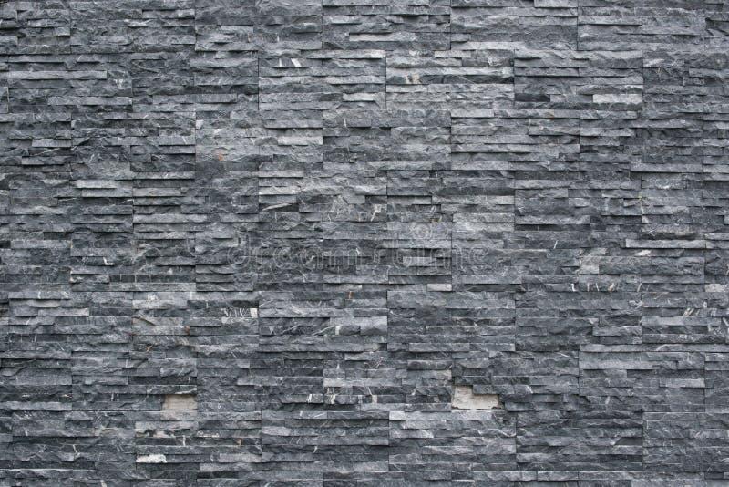 De muur van de achtergrond leisteen textuur Decoratief metselwerk royalty-vrije stock foto