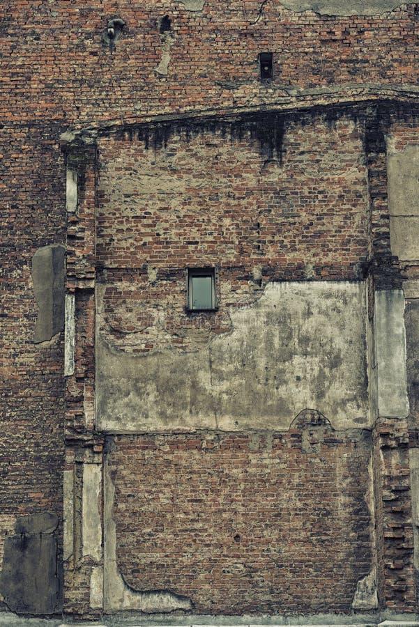 De muur van de ruïneuze bouw stock foto's