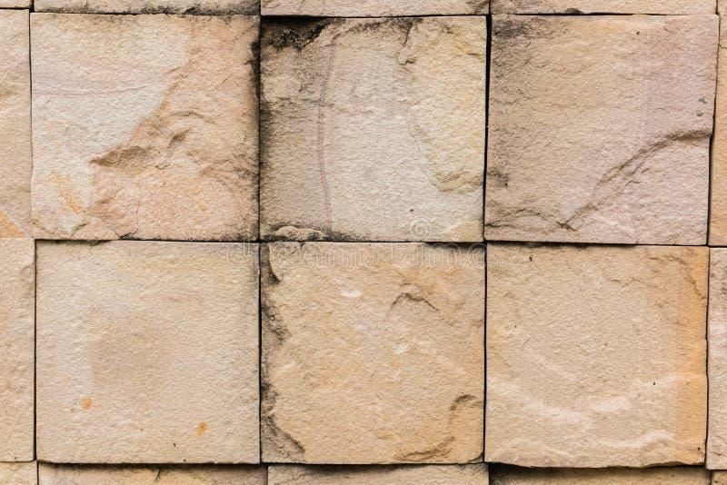 De muur van de steen die met blokken wordt gemaakt stock foto