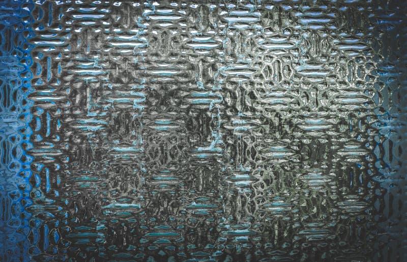 De muur van het glas In reliëf gemaakte glas blauwe tint stock foto's