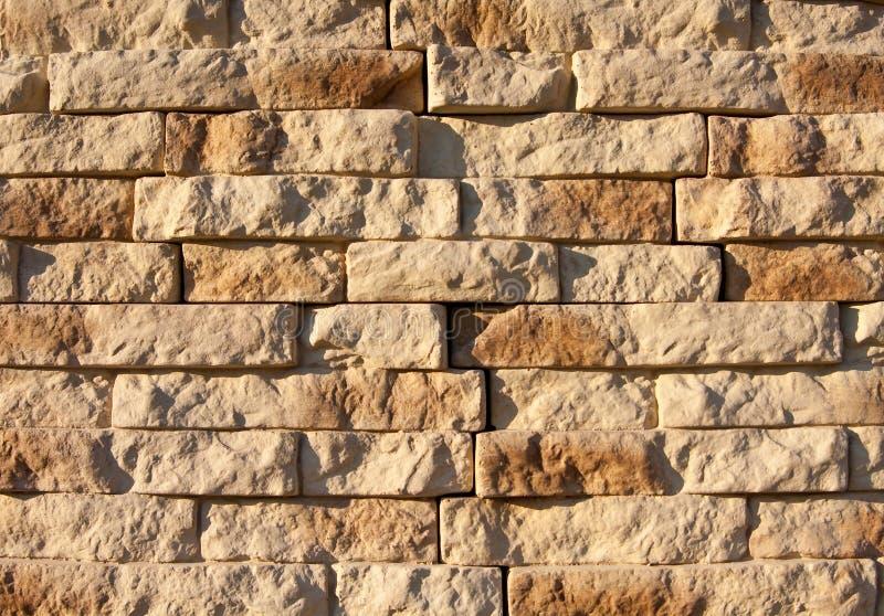 De muurachtergrond van de rots stock afbeeldingen