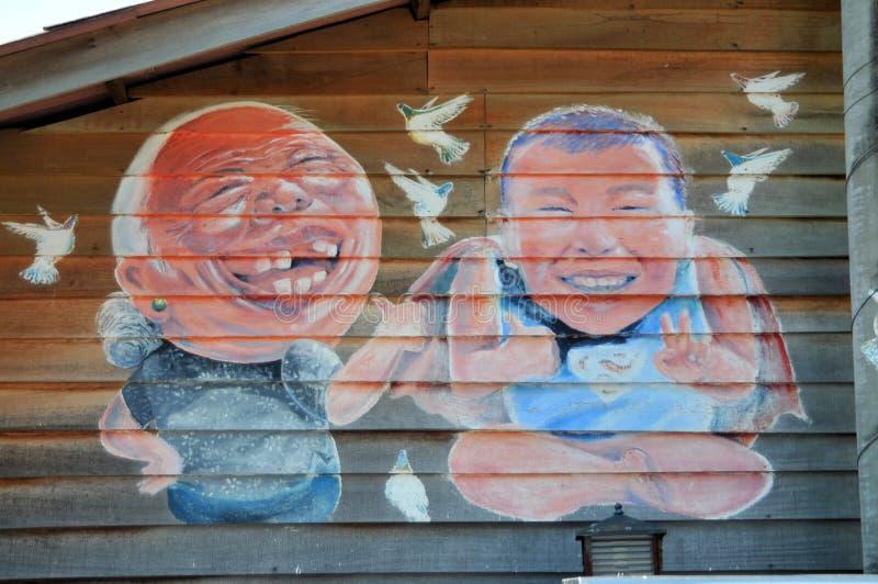 De muurschildering van Ah Kong & Ah Mah Grandmother & Kleinzoon 'schilderde door Simon Tan royalty-vrije stock afbeelding
