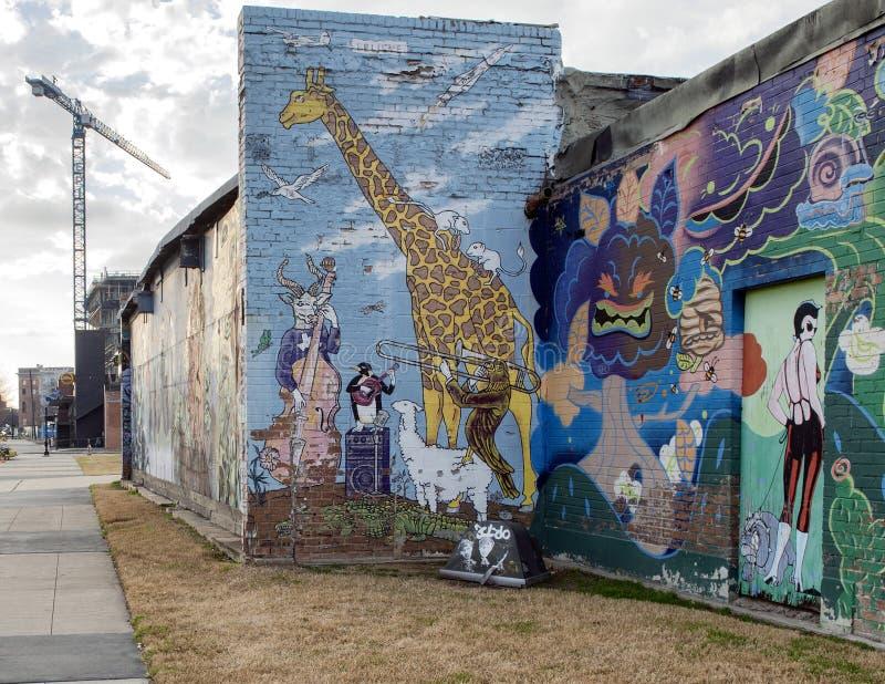 De muurschildering van de muurkunst in Diepe Ellum, Dallas, Texas stock afbeeldingen