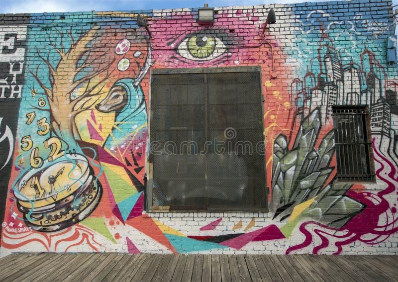 De muurschildering van de muurkunst in Diepe Ellum, Dallas, Texas stock foto's