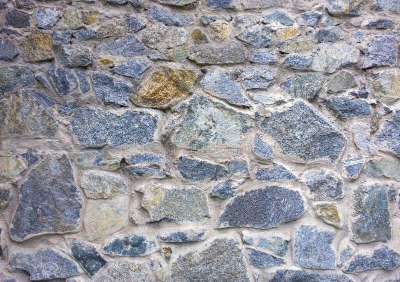 De muurtextuur van de steen symmetrische vormen in cementbetonmolens Oude vesting wal royalty-vrije stock afbeeldingen