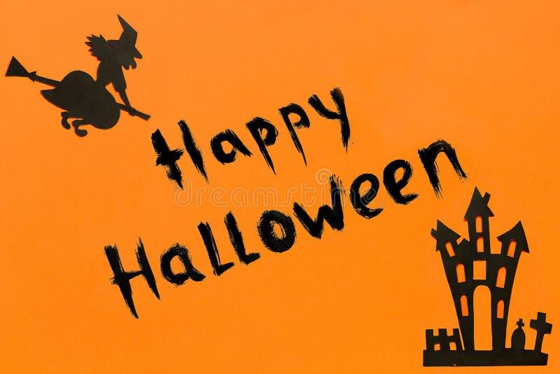 De muziek van de nacht Het document van tekst Gelukkig Halloween Zwart Heks en spookhuiskasteel en zwart kader op oranje achtergr royalty-vrije stock foto's