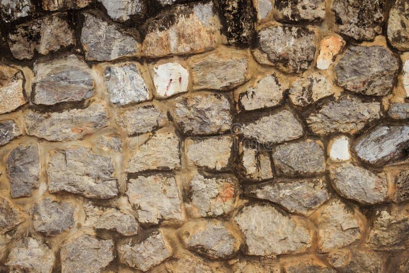 De naadloze textuur van de rotsmuur voor achtergrond Decoratieve ongelijke cra stock foto's