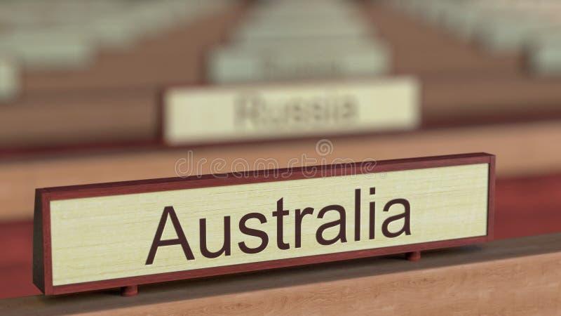 De naamteken van Australië onder de verschillende plaques van landen bij internationale organisatie het 3d teruggeven vector illustratie