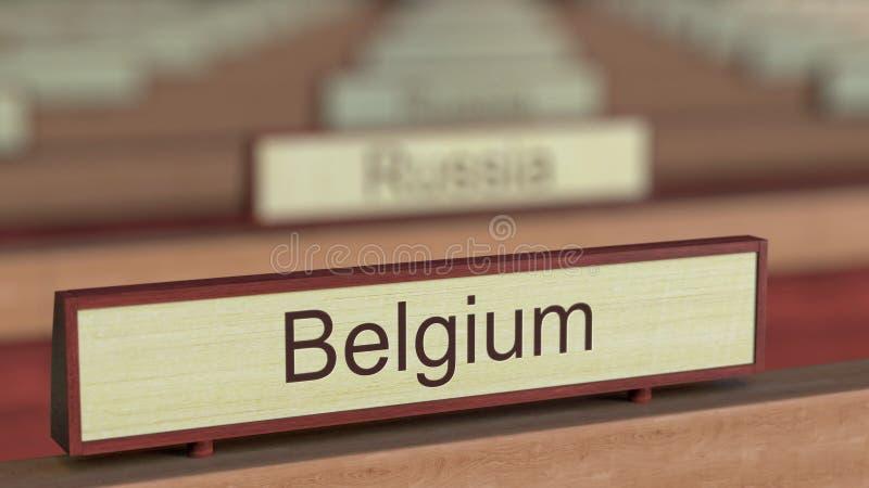 De naamteken van België onder de verschillende plaques van landen bij internationale organisatie het 3d teruggeven royalty-vrije illustratie