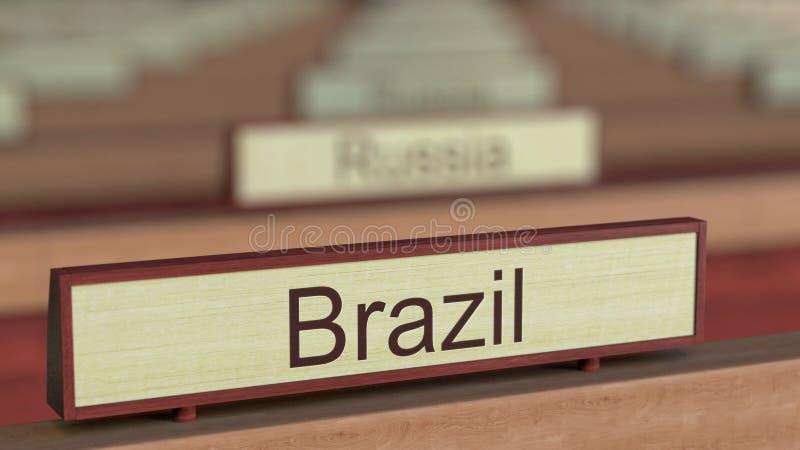 De naamteken van Brazilië onder de verschillende plaques van landen bij internationale organisatie het 3d teruggeven royalty-vrije illustratie