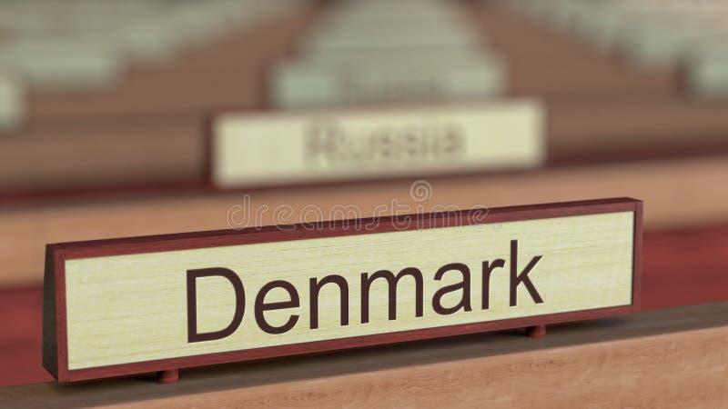 De naamteken van Denemarken onder de verschillende plaques van landen bij internationale organisatie het 3d teruggeven vector illustratie