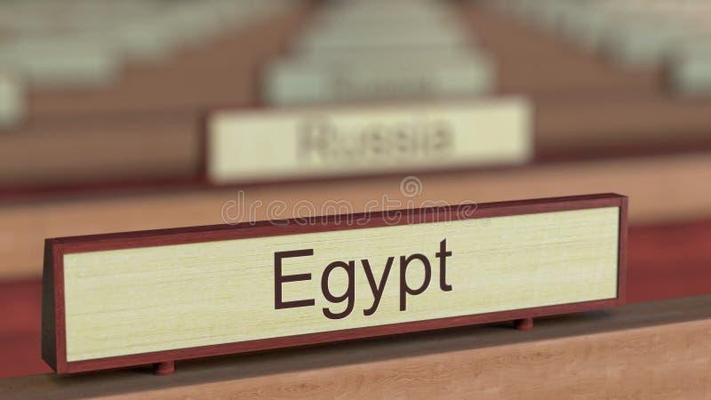 De naamteken van Egypte onder de verschillende plaques van landen bij internationale organisatie het 3d teruggeven royalty-vrije illustratie