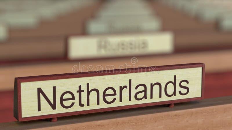 De naamteken van Nederland onder de verschillende plaques van landen bij internationale organisatie het 3d teruggeven royalty-vrije illustratie