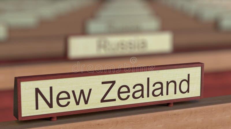 De naamteken van Nieuw Zeeland onder de verschillende plaques van landen bij internationale organisatie het 3d teruggeven stock illustratie