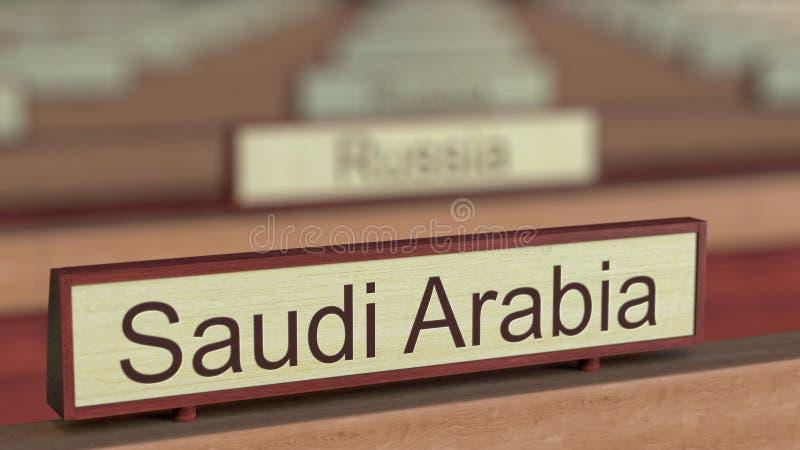 De naamteken van Saudi-Arabië onder de verschillende plaques van landen bij internationale organisatie het 3d teruggeven stock illustratie