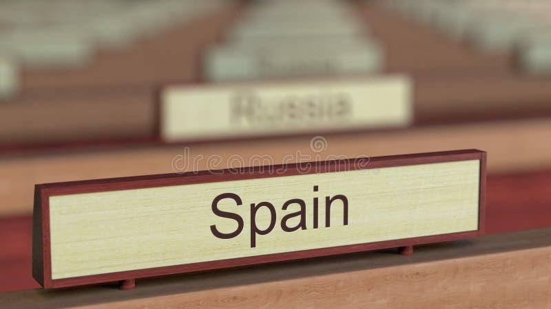 De naamteken van Spanje onder de verschillende plaques van landen bij internationale organisatie het 3d teruggeven vector illustratie