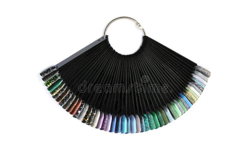 De nagellaksteekproeven sluiten omhoog op een witte achtergrond, kleurrijke nai stock afbeelding