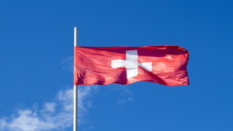 De nationale vlag van het land Zwitserland stock fotografie