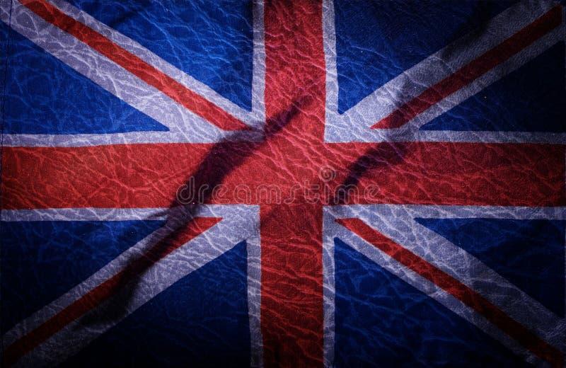 De nationale vlag van het Verenigd Koninkrijk op grungeachtergrond stock afbeelding