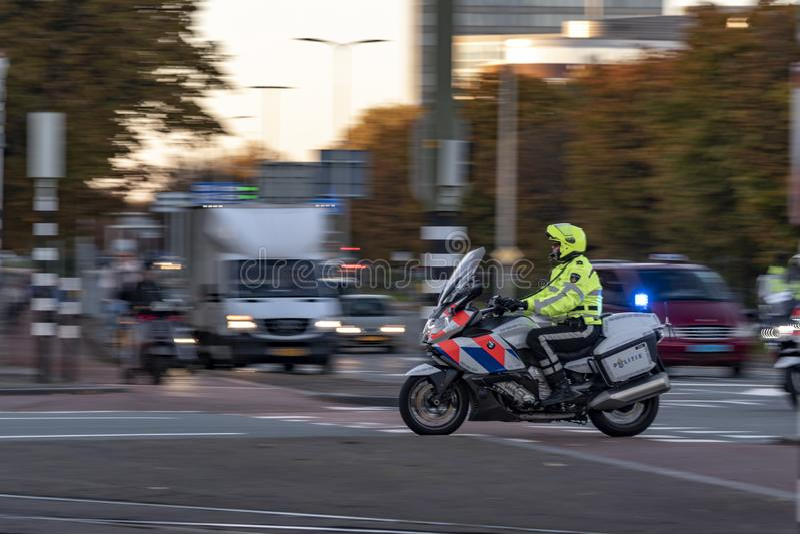 De Nederlandse motor van de politiemens stock foto