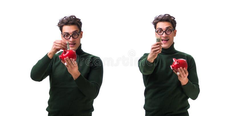 De nerd jonge die man met piggybank op wit wordt ge?soleerd royalty-vrije stock afbeelding