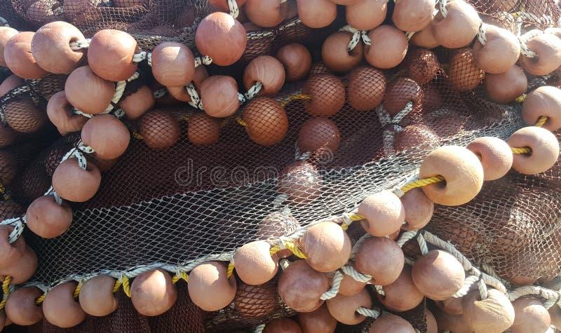 De netten van de visserij en vlotters stock afbeeldingen