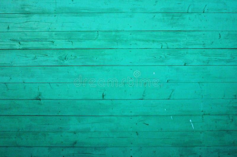 De niet gepolijste achtergrond van de wintertalings houten textuur Sjofele die planken in lichtgroene kleur worden geschilderd Gu stock foto
