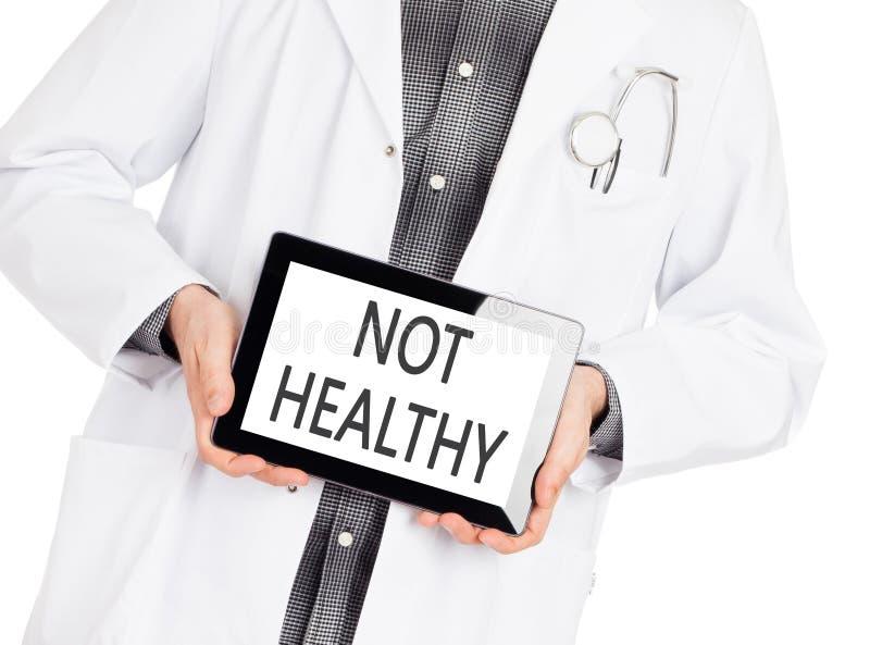 De niet gezonde tablet van de artsenholding - stock afbeelding