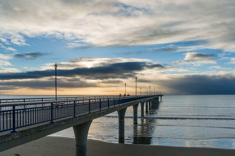 De nieuwe pijler van Brighton op zonsopgang stock afbeelding