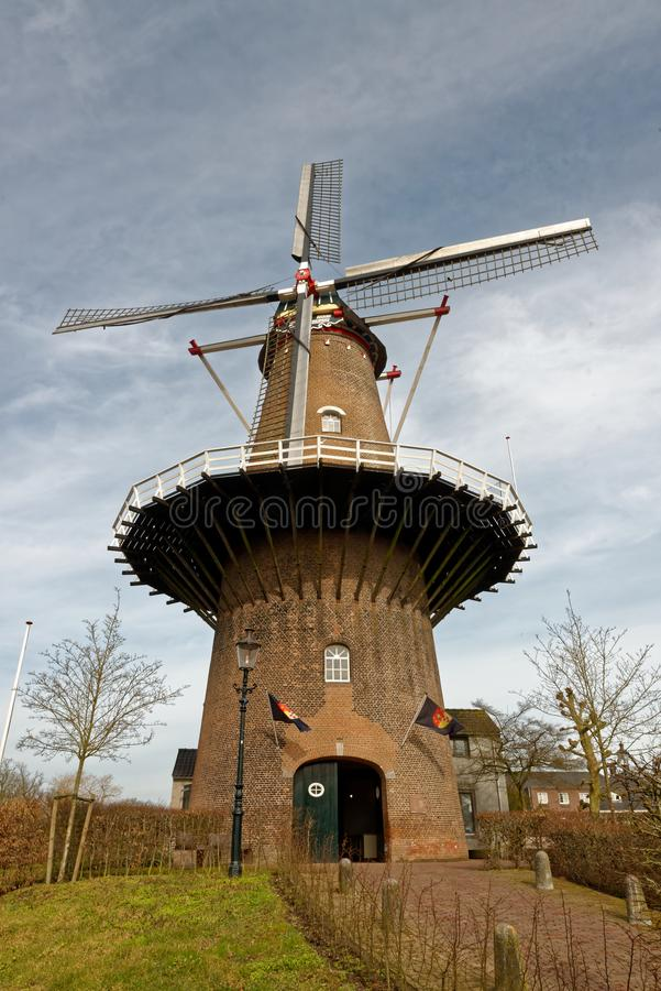 De Nijverheid Windmill in Ravenstein, The Netherlands. Ravenstein is a city and a former municipality in the south of the Netherlands, in the province of North royalty free stock photo