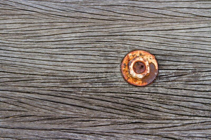 De noot is roest op oude houten vloer stock fotografie