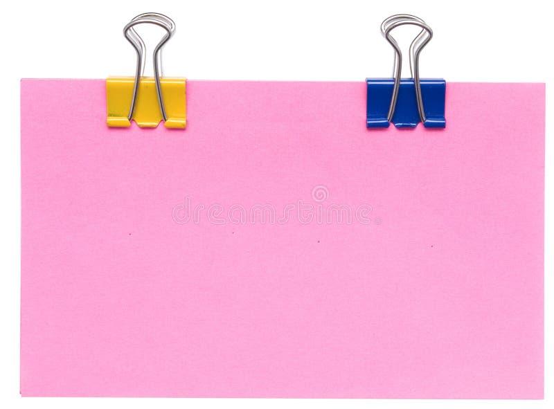 De nota en de klemmen van het document stock foto's