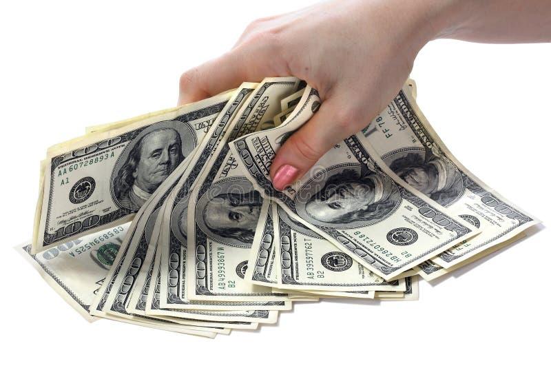 De nota's van dollars zijn in handen. stock afbeeldingen