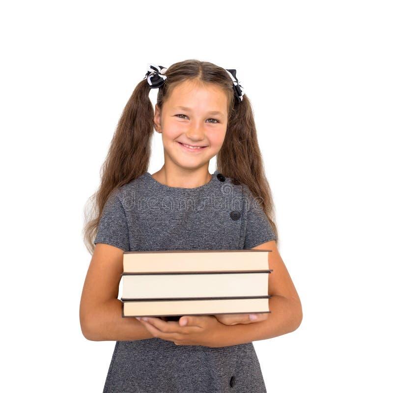 De nouveau à l'école ! L'écolier de sourire tient des livres photographie stock libre de droits