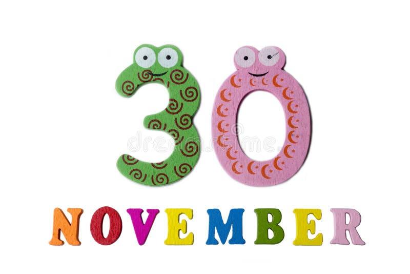 30 de novembro, em um fundo branco, em números e em letras fotos de stock royalty free