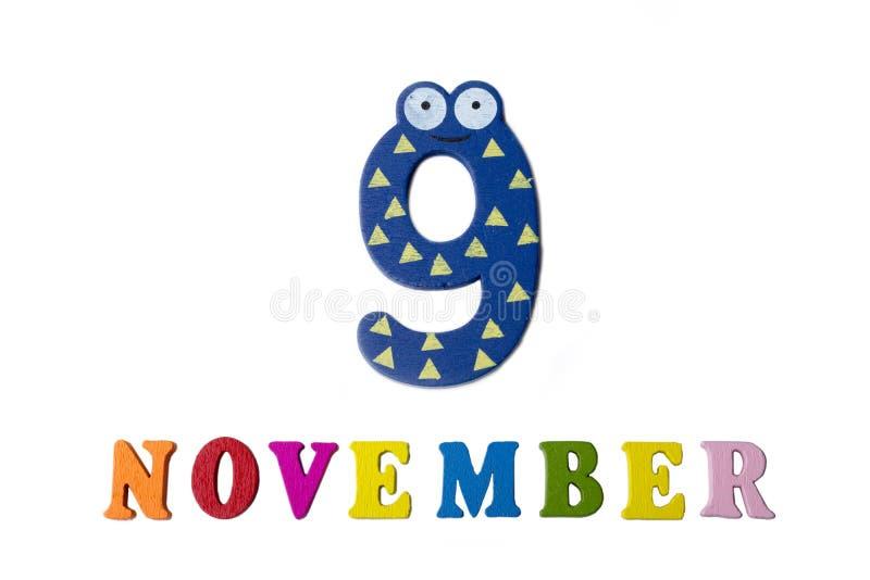 9 de novembro no fundo, nos números e nas letras brancos fotografia de stock royalty free